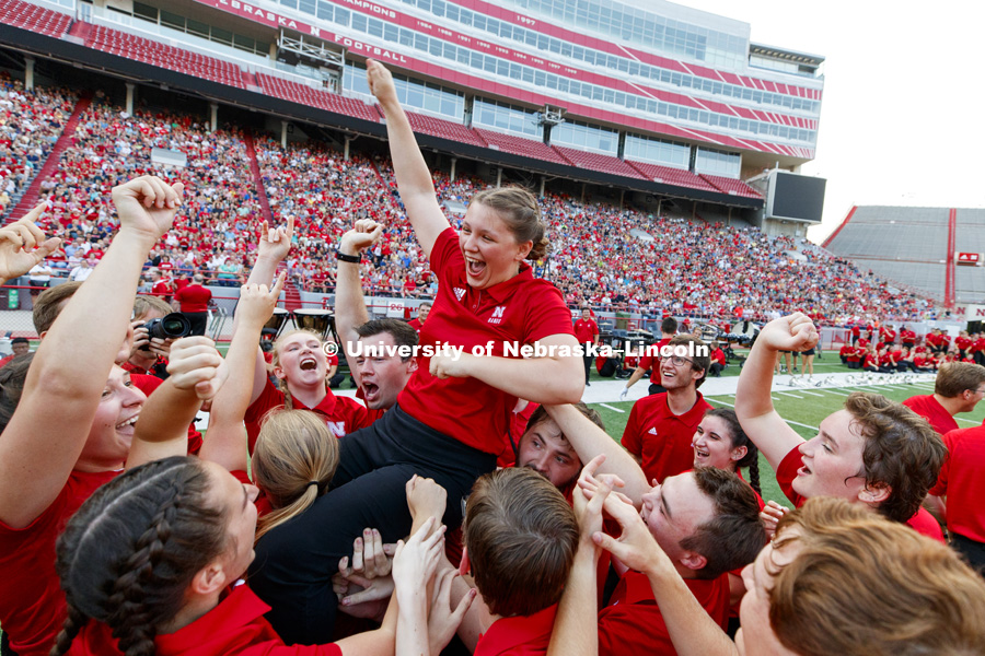 Sophia Kallas of Green Bay, Wisconsin, is carried aloft after the junior mellophone player won the march off competition at the Cornhusker Marching Band Exhibition. August 17, 2018. Photo by Craig Chandler / University Communication.