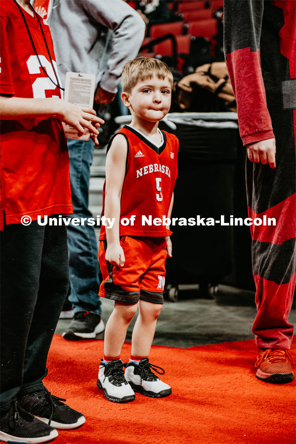 A young Husker fan waits for the basketball team to come through the tunnel walk. Nebraska vs. Michigan State University men's basketball game. February 20, 2020.  Photo by Justin Mohling / University Communication.