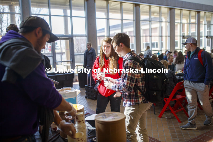 Miranda Mueller smiles after getting a root beer float as part of Lunch In The Lobby in the Animal Science building lobby, a part of CASNR week. March 11, 2020. Photo by Craig Chandler / University Communication.