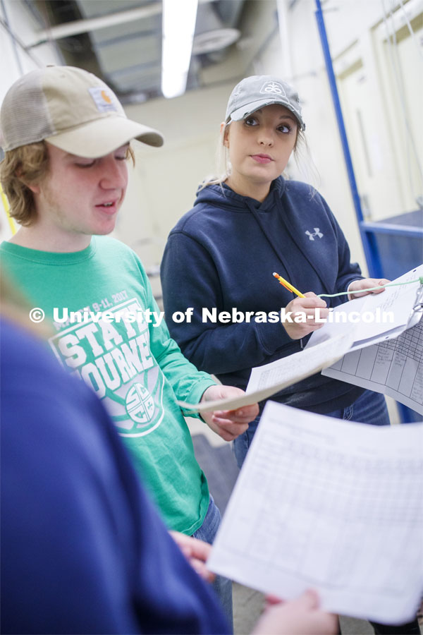 Lexie Schuster, senior in Animal Science from Elk Creek, NE, listens as her group finishes their documentation on their farrowing results. Students in ASCI 150 - Animal Production Skills. March 12, 2020. Photo by Craig Chandler / University Communication.