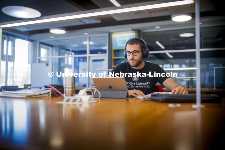 Ramsey Jaber, a 2015 UNL alumni, studies his medical texts in Love Library Tuesday. He is a student of St. George's University school of medicine in Granada and moved back to Lincoln when they closed their campus. City Campus. March 17, 2020. Photo by Craig Chandler / University Communication.