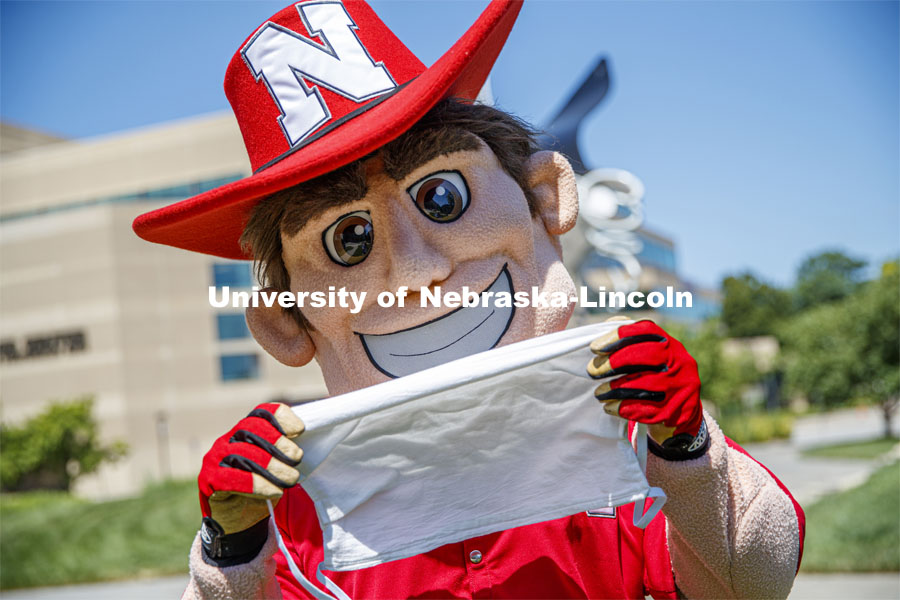 Herbie Husker wears a protective mask while he poses on campus. July 09, 2020. Photo by Craig Chandler / University Communication.