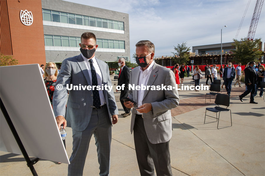 Zach Wiegert, principal of Goldenrod Companies and UNL Chancellor Ronnie Green look over renderings of the new hotel after the reveal. The Scarlet Hotel name was revealed today to announce the new hotel being built at Nebraska Innovation Campus. The hotel will be home to academic space managed by the University of Nebraska–Lincoln's College of Education and Human Sciences and will house the Hospitality, Restaurant and Tourism Management program. August 18, 2020. Photo by Craig Chandler / University Communication.