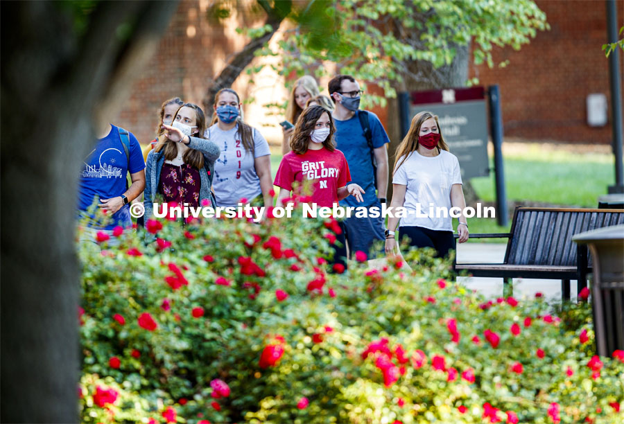 Students are masked up as they cross campus to get to their classes. First day for in-person learning for the fall semester. August 24, 2020. Photo by Craig Chandler / University Communication.