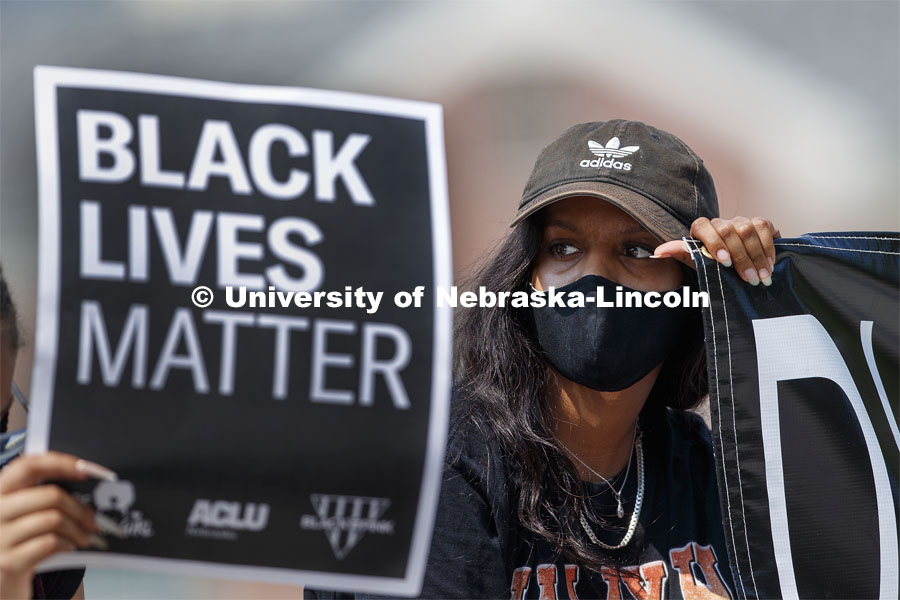Batool Ibrahim holds one end of a Black Lives Matter banner at the sit-in sponsored by the Black Student Union to draw attention to the shooting of Jacob Blake in Kenosha, WI. August 25, 2020. Photo by Craig Chandler / University Communication.