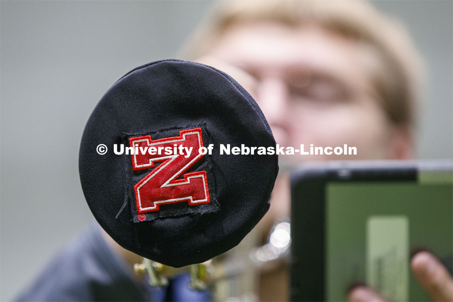 Band members have used ingenuity to cover their horn's bell. Cornhusker Marching Band practice in Cook Pavilion. September 10, 2020. Photo by Craig Chandler / University Communication.