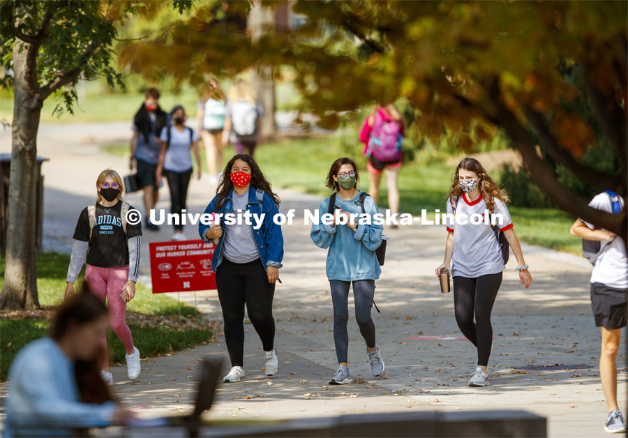 Students cross campus to get to classes. Wearing masks on city campus. September 21, 2020. Photo by Craig Chandler / University Communication.