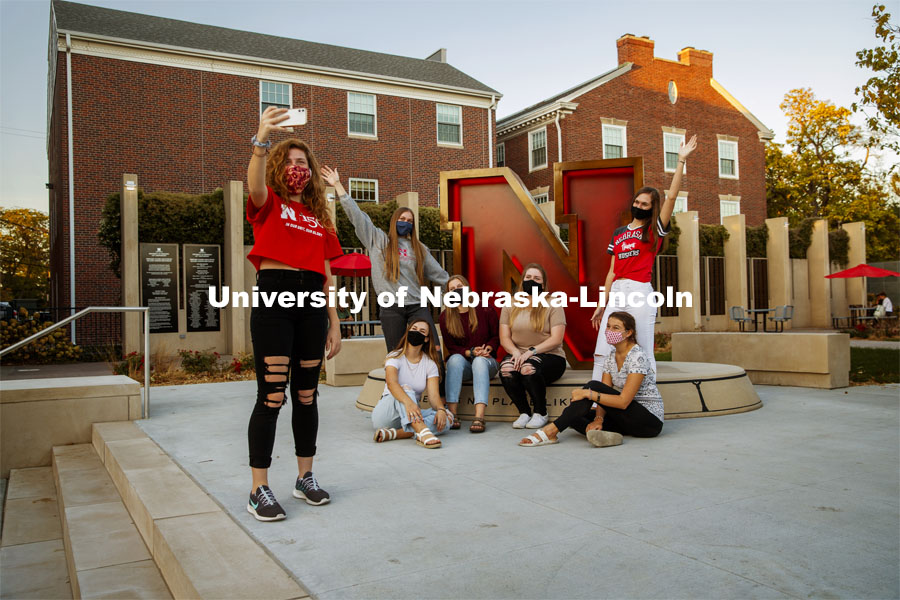 "A group of Delta Delta Delta sorority sisters do a group photo in front of the ""N"" sculpture at the Wick Alumni Center. October 13, 2020. Photo by Craig Chandler / University Communication."
