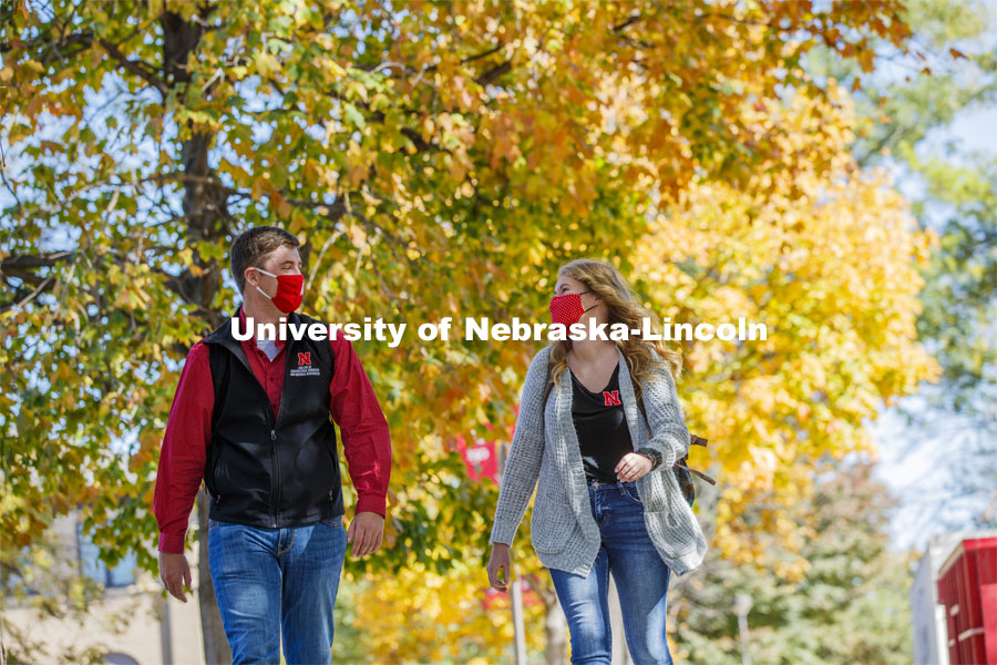 Sydney Brewer and Jordan Popp walk outside the Nebraska East Union. East Campus photo shoot. October 13, 2020. Photo by Craig Chandler / University Communication.