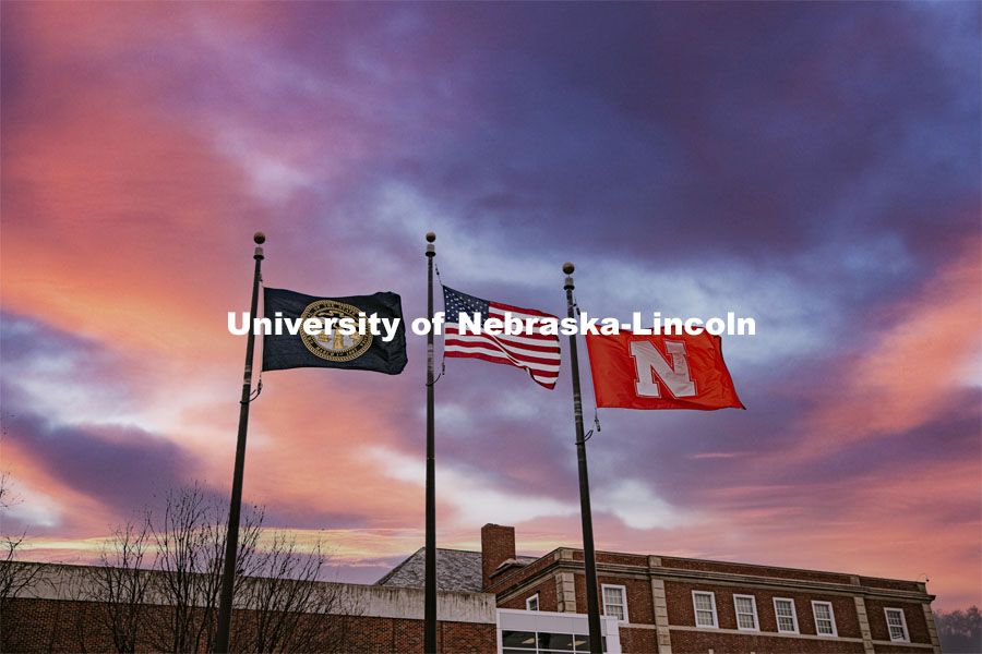 High winds whip the flags between Canfield Hall and the Nebraska Union. January 14, 2021. Photo by Craig Chandler / University Communication.