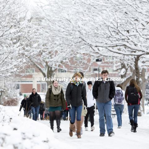 Students walk across campus following a snow storm. January 30, 2013. Photo by Craig Chandler / University Communications