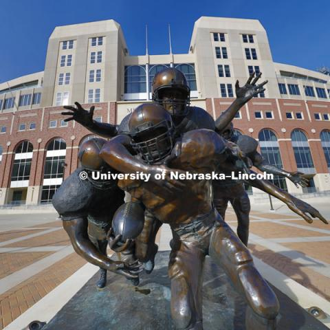 Football statue, The Legacy, is located outside of east Memorial Stadium. March 1, 2016. Photo by Craig Chandler / University Communications