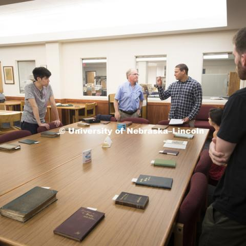 Kenneth Price, the Hillegass University Professor of American literature at Nebraska, shows part of the library's collection of Walt Whitman's work to his class.  August 23, 2016. Photo by Craig Chandler / University of Nebraska