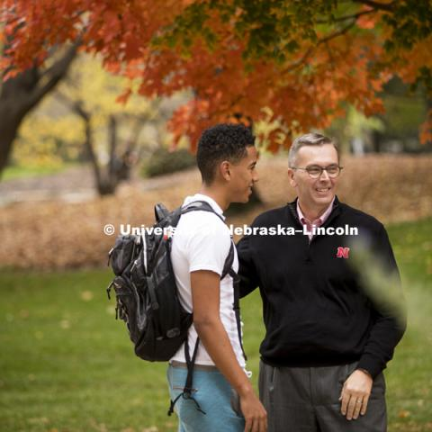 Chancellor Ronnie Green stops to talk to students as the cross campus to get to their classes. October 26, 2016. Photo by Craig Chandler / University Communication.