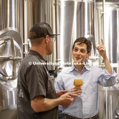 "Andre Maciel studies a Boiler Brewing Company India pale ale called THAT! — an acronym for Totally Hazy and Turbid. Taproom manager Thad Aerts said the brew has flavors of grapefruit and orange, with a ""super, super hoppy"" nose. Maciel is a marketing"