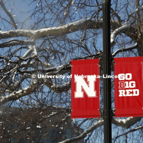 Snow, squirrels and banners on city campus. January 5, 2017. Photo by Craig Chandler / University Communication.