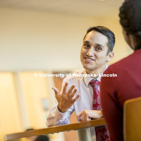 Moises Padilla, Assistant Director of the Office of Academic Success and Intercultural Services (OASIS) talks with a co-worker in the Jackie Gaughan Multicultural Center. January 10, 2017. Photo by Craig Chandler / University Communication.