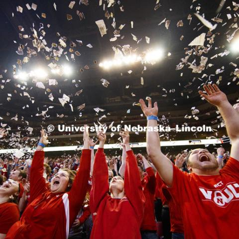Students  throw newsprint confetti into the air to celebrate the first Husker basket of the game.  The student section ritual is a Husker tradition. Nebraska mens basketball vs. Ohio State at the Pinnacle Bank Arena.  January 18, 2017, Photo by Craig