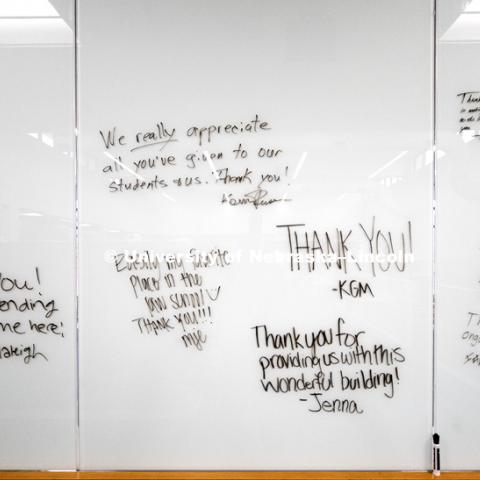 Students write out thank-you's on a glass marker wall to donors attending the open house. Opening of new Marvin and Virginia Schmid Law Clinic and unveiling of former Dean Susan Poser portrait. March 31, 2017. Photo by Craig Chandler / University