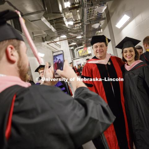 Backstage awaiting the ceremony to begin. Grads pose for pictures. Students earning graduate and professional degrees received their diplomas Friday afternoon in Lincoln's Pinnacle Bank Arena. Undergraduate commencement is Saturday morning in the Arena.