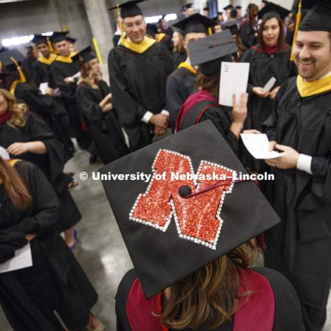 "Chelsea Joekel, master's student in Speech-Language Pathology and Audiology, decorated her mortarboard with the Nebraska ""N"". Students earning graduate and professional degrees received their diplomas Friday afternoon in Lincoln's Pinnacle Bank Arena."