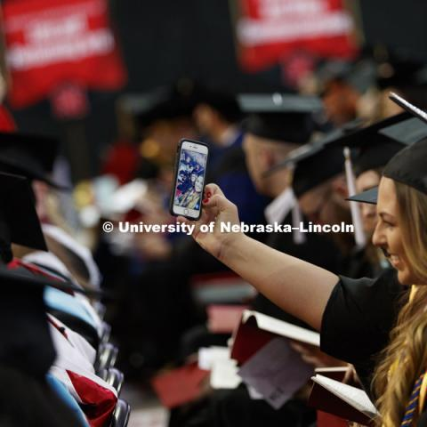Alexandria Leavenworth takes a selfie of her and Amy Lester while seated in the arena. Students earning graduate and professional degrees received their diplomas Friday afternoon in Lincoln's Pinnacle Bank Arena. Undergraduate commencement is Saturday