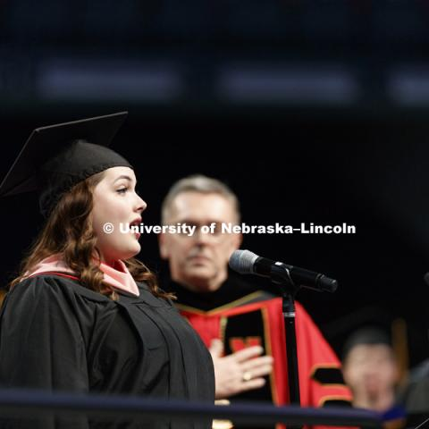 Emily Triebold sings the National Anthem. Triebold also received her masters of music degree during the ceremony. Students earning graduate and professional degrees received their diplomas Friday afternoon in Lincoln's Pinnacle Bank Arena. Undergraduate