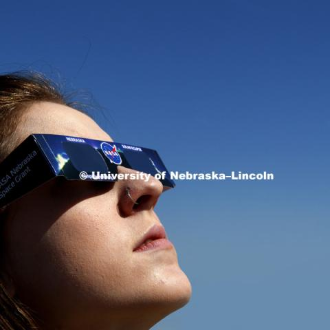 Hannah Paxton, senior in advertising and marketing, and Teaching Assistant for Professor Michael Sibbernsen, eyes the sun using NASA-provided safety glasses. Michael Sibbernsen, Lecturer of Astronomy- University of Nebraska-Lincoln, Special Projects