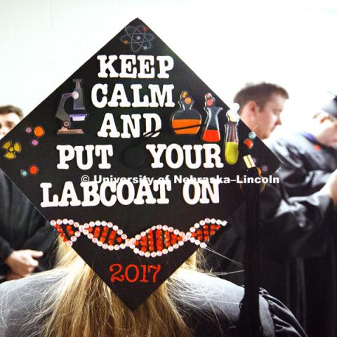 Nichole Leacock decorated her mortarboard to celebrate her Forensic Science major as part of CASNR. Students received their undergraduate diplomas Saturday morning in Lincoln's Pinnacle Bank Arena. 2452 degrees were awarded Saturday morning. May 6, 2017.