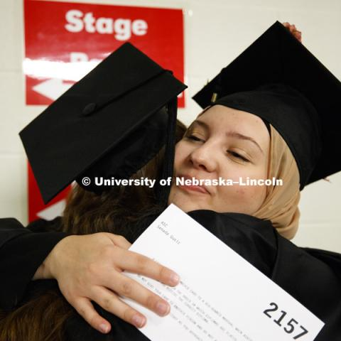Senada Gusic hugs Rachel Urban before commencement while lining up in the hallways off the arena floor. Students received their undergraduate diplomas Saturday morning in Lincoln's Pinnacle Bank Arena. 2452 degrees were awarded Saturday morning. May 6,