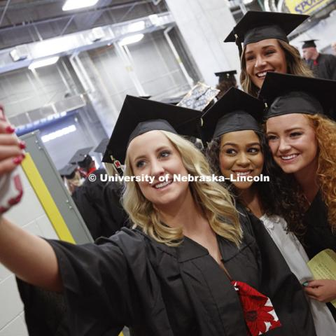 Megan Gould, Kiara Moody. Cassandra Jane Wilka and Courtney Belden take a selfie while waiting for commencement to begin. Students received their undergraduate diplomas Saturday morning in Lincoln's Pinnacle Bank Arena. 2452 degrees were awarded Saturday