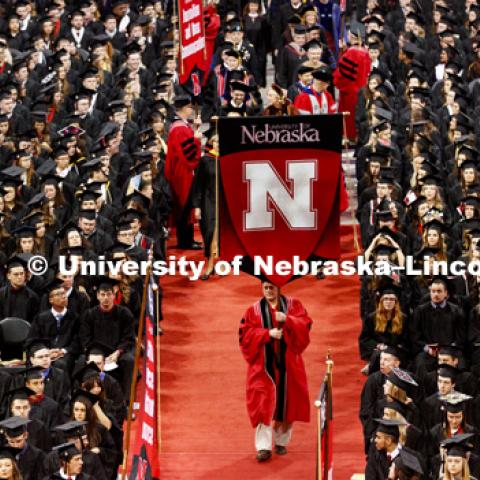 The stage party procession enters the arena after the students were seated. Students received their undergraduate diplomas Saturday morning in Lincoln's Pinnacle Bank Arena. 2452 degrees were awarded Saturday morning. May 6, 2017. Photo by Craig Chandler