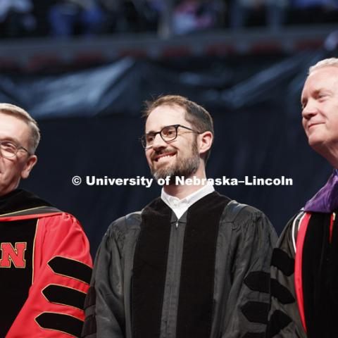 Chancellor Ronnie Green, Evan Williams, (Nebraska native and founder of Twitter), and Regent Timothy Clare listen to William's introduction. Students received their undergraduate diplomas Saturday morning in Lincoln's Pinnacle Bank Arena. 2452 degrees