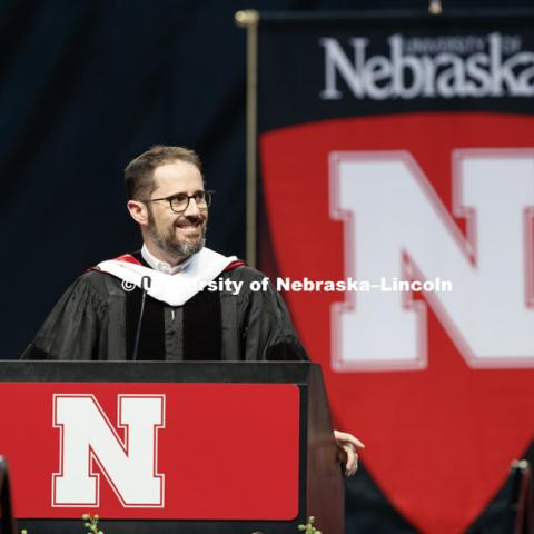 "Evan Williams, Nebraska native and founder of Twitter, smiles at his family in the arena while delivering the commencement address. Williams received an honorary degree before he delivered the Commencement Address ""Farm Kid Swipes Fire"". Students received"