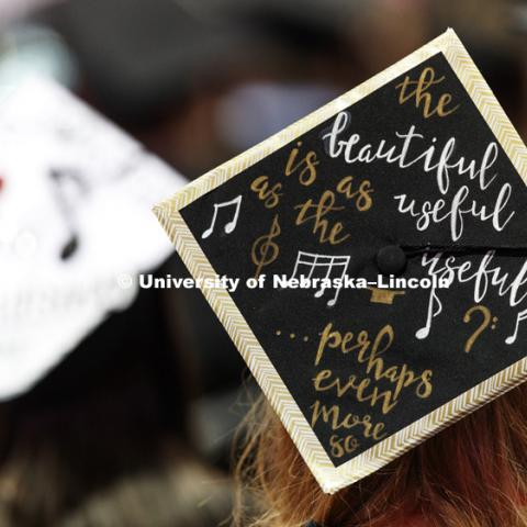 Decorated mortarboards in a sea of graduates. Students received their undergraduate diplomas Saturday morning in Lincoln's Pinnacle Bank Arena. 2452 degrees were awarded Saturday morning. May 6, 2017.  Photo by Craig Chandler / University Communication.