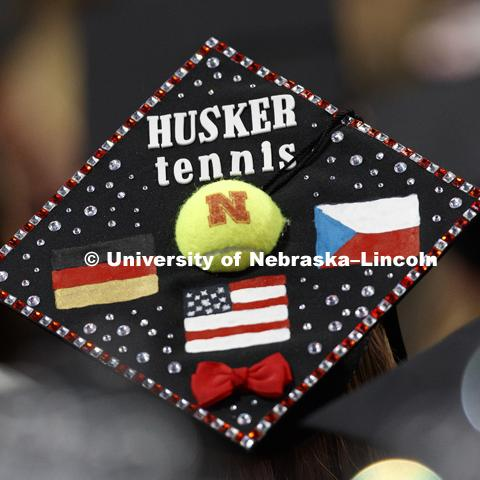 Katerina Matysova, a Husker tennis athlete from Erding, Germany, sports a distinctive mortarboard in the sea of graduates. Students received their undergraduate diplomas Saturday morning in Lincoln's Pinnacle Bank Arena. 2452 degrees were awarded Saturday