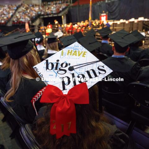 A college of architecture graduate's decorated mortarboard in a sea of graduates. Students received their undergraduate diplomas Saturday morning in Lincoln's Pinnacle Bank Arena. 2452 degrees were awarded Saturday morning. May 6, 2017. Photo by Craig