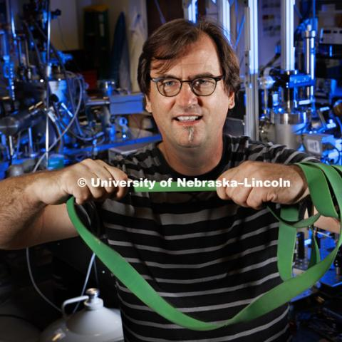 Just as muscle power can effect the elasticity of a workout band, Christian Binek has demonstrated how magnetism can change the elasticity of a material. September 18, 2016.  Photo by Craig Chandler / University Communication.