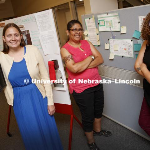 Alexis Swendener, Linda Garcia Merchant, and Grace Brown display the variety of projects they have been able to bring to fruition working in the Digital Scholarship Incubator. August 1, 2017. Photo by Craig Chandler / University Communication.