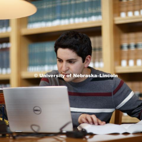 Daniel Segura studies in the law library. College of Law photo shoot. September 14, 2017. Photo by Craig Chandler / University Communication.