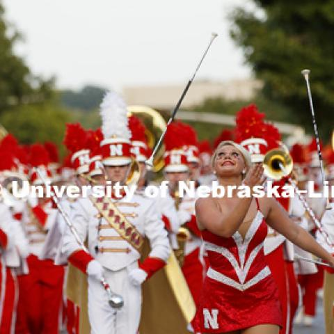 Cornhusker Marching Band twirler Hannah Kollmann leads the band down the street. Homecoming parade, pep rally and court jester competition. September 22, 2017. Photo by Craig Chandler / University Communication.