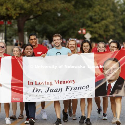 Students walked the parade carrying a banner honoring the late Dr. Juan Franco. Homecoming parade, pep rally and court jester competition. September 22, 2017. Photo by Craig Chandler / University Communication.