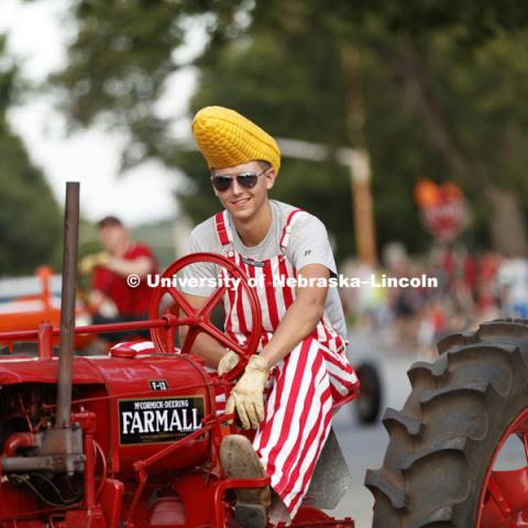 The tractor restoration club drove many of the tractors from East Campus' Tractor Museum. Homecoming parade, pep rally and court jester competition. September 22, 2017. Photo by Craig Chandler / University Communication.