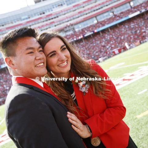 Newly engaged homecoming king and queen Shayne Arriola and Laura Springer pose for photos after the halftime ceremony and proposal. It was a memorable day for University of Nebraska-Lincoln seniors Shayne Arriola and Laura Springer, both of Grand Island.