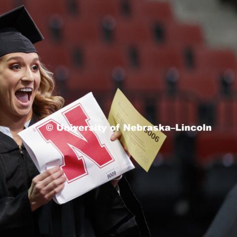 Tayler Bauer shows off her CEHS diploma. Undergraduate Commencement at Pinnacle Bank Arena. December 16, 2017. Photo by Craig Chandler / University Communication.