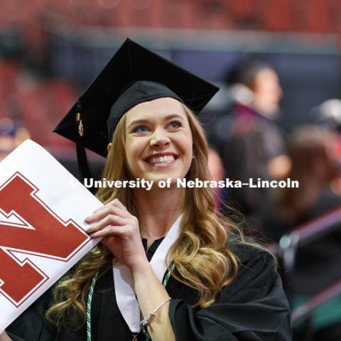 Catherine Doering shows off her CEHS diploma. Undergraduate Commencement at Pinnacle Bank Arena. December 16, 2017. Photo by Craig Chandler / University Communication.