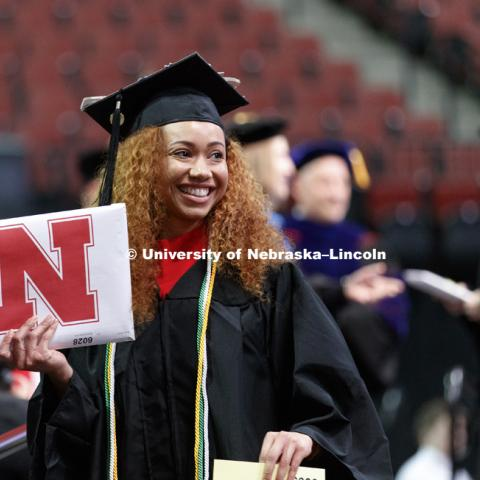 Wylicia Dorsey shows off her CEHS diploma to family and friends. Undergraduate Commencement at Pinnacle Bank Arena. December 16, 2017. Photo by Craig Chandler / University Communication.
