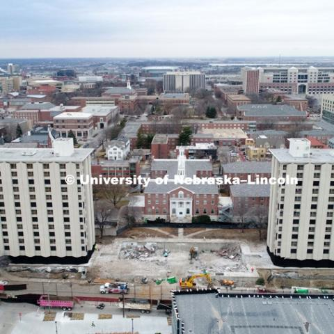Cather Residence Hall (right) and Pound Residence Hall (left) are to be imploded Friday morning at 9 a.m. The area between the two is the demolished dining center. The surrounding buildings are being protected by walls of fabric to catch dust and any
