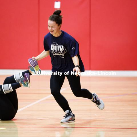 Miranda Fendrich unfreezes Emily Hetmanek during a game of tag. Masters students in TEAC 893 Seminar Workshop in Health & Physical Education apply learning principals to physical education games in Mabel Lee hall gymnasium.  January 12, 2018. Photo by