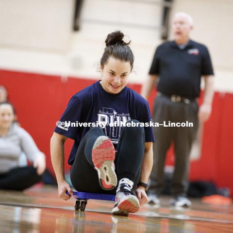 Miranda Fendrich works on her scooter techniques. Masters students in TEAC 893 Seminar Workshop in Health & Physical Education apply learning principals to physical education games in Mabel Lee hall gymnasium.  January 12, 2018. Photo by Craig Chandler /